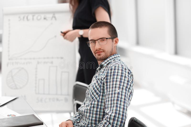 Close up.young employee sitting at his Desk. Photo with copy space stock image