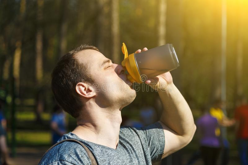 Close up young exhausted athlete drinking and pouring fresh water to refresh during running trail stock photos