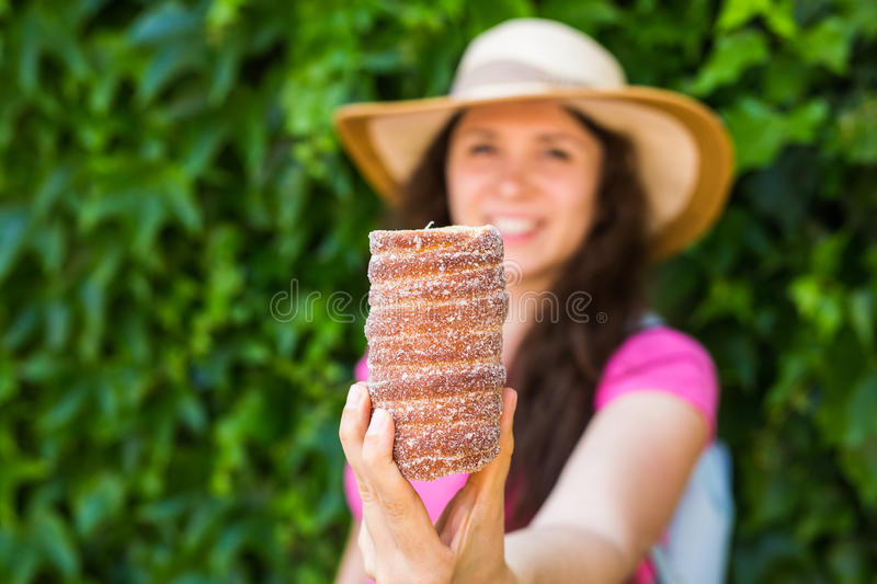 Close-up of young female tourist with traditional czech dessert trdelnik in Prague. Czech Republic. Outdoor.  stock photos