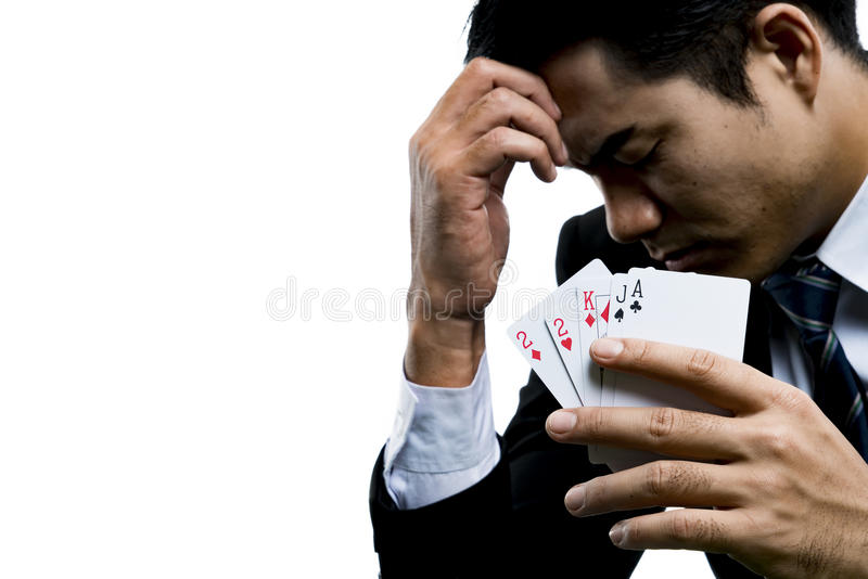 Close up the young gambler used a hand off the face with the stress royalty free stock image