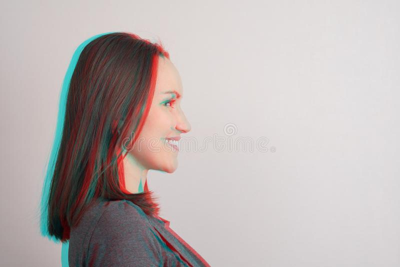 Close-up of young girl in profile,anaglyph effect, glitch. Copy space stock images