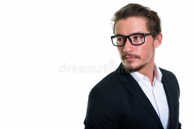 Close up of young handsome businessman thinking while looking ba royalty free stock photography