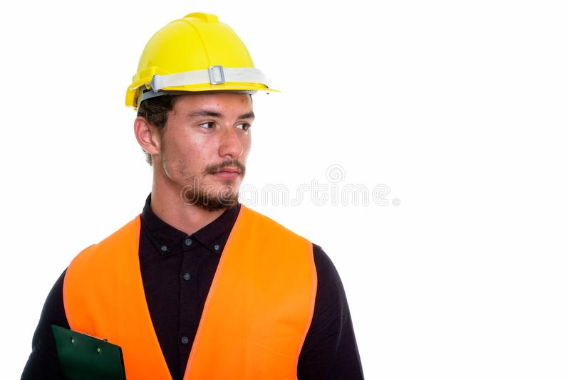 Close up of young handsome man construction worker thinking whil stock photography