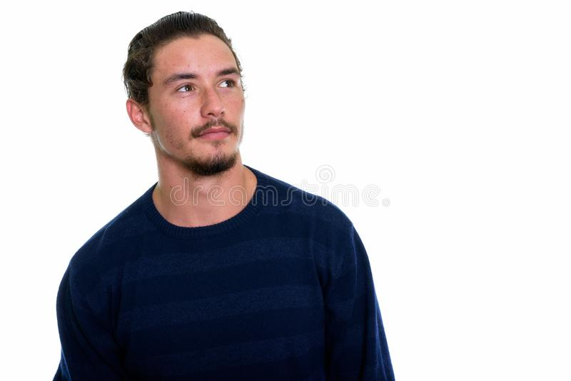 Close up of young handsome man thinking isolated against white b stock photos