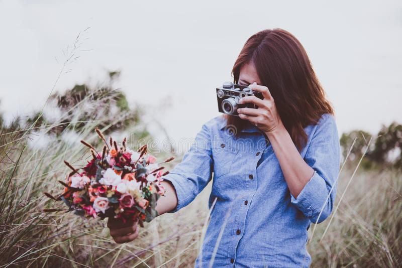 Close up of young hipster woman hand holding retro camera and sh royalty free stock image