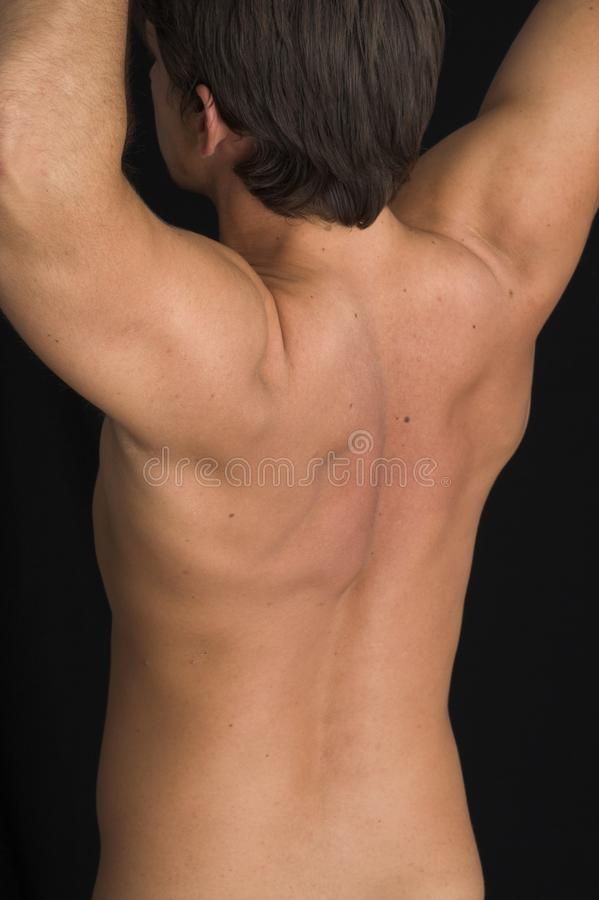 Close up of a young man back stock photography