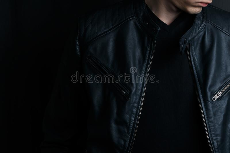 Close-up young man in a black leather jacket stock images