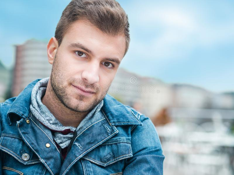 Close-up of a young man. Headshot of gorgeus guy. Outdoor, outside stock image