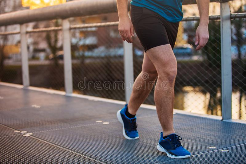 Close up of young man sporty legs running outdoor stock photos
