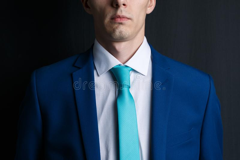 Close-up young man in an suit. He is in a white shirt with a tie. His face unshaven royalty free stock photos