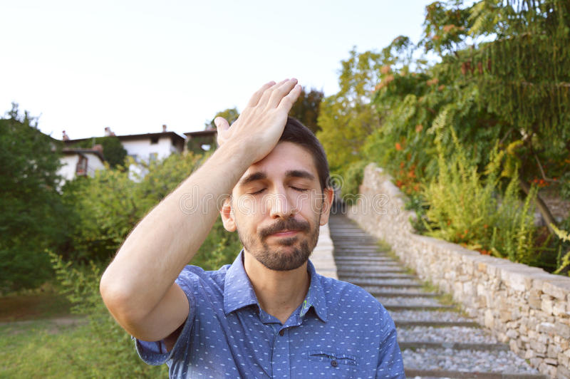 Close up of a young man who forgot something important stock photos