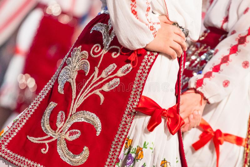 Close up of young Romanian dancers perform a folk dance in traditional folkloric costume. Folklore of Romania. Close up s of young Romanian dancers perform a royalty free stock photography