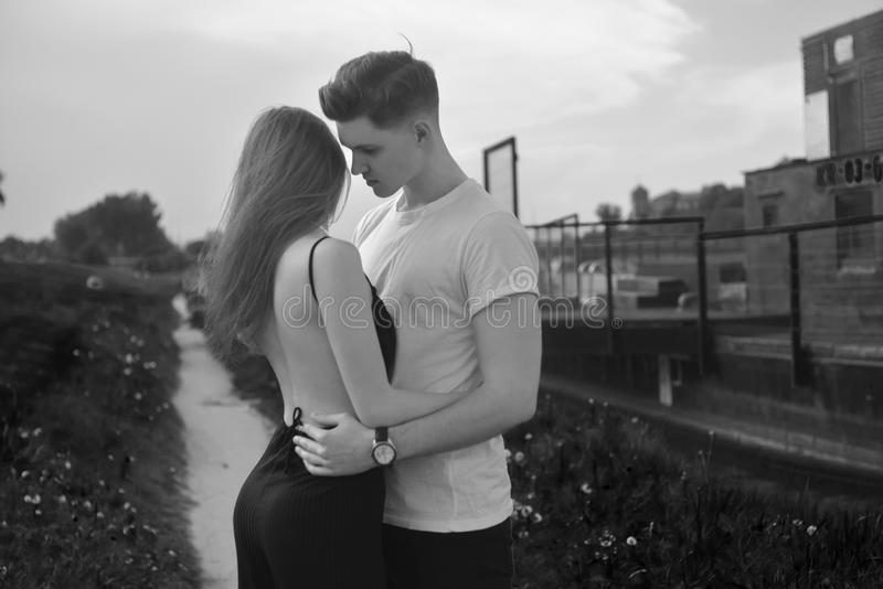 Close-up of young romantic couple is kissing and enjoying the company of each other in black and white. Young couple in love. Hug each other. girl in black royalty free stock photos