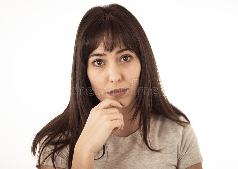 Portrait of sad and depressed woman. Isolated on white background. Human expressions and emotions stock photography