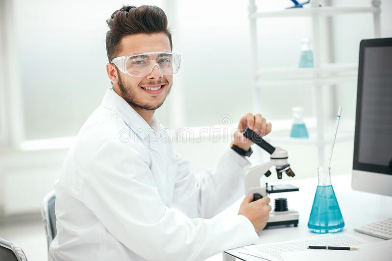 Close up. young scientist checking tests for coronavirus royalty free stock photography