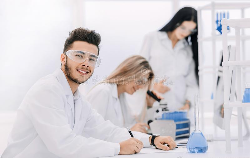 Close up.young scientist sitting at his Desk in the laboratory royalty free stock photo