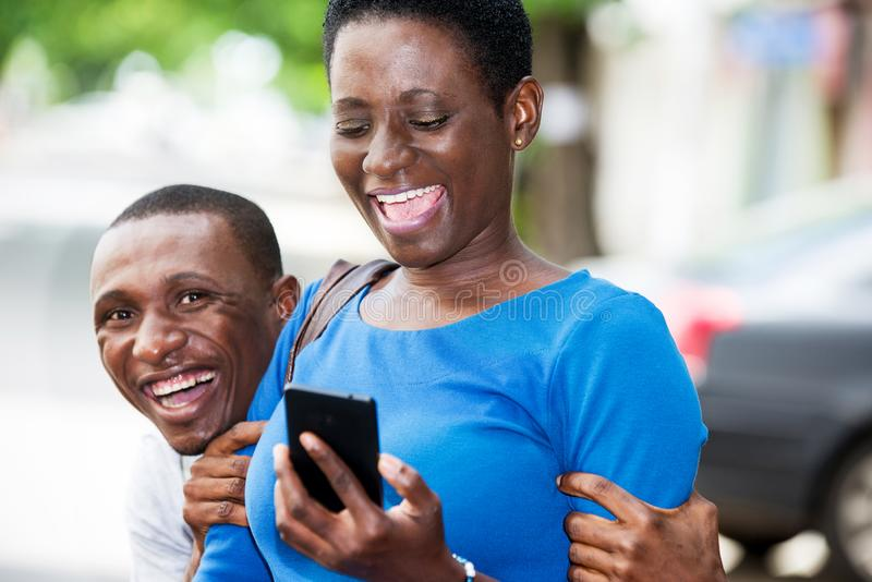 Close up of young students, happy. Young students standing with mobile phone laughing stock images