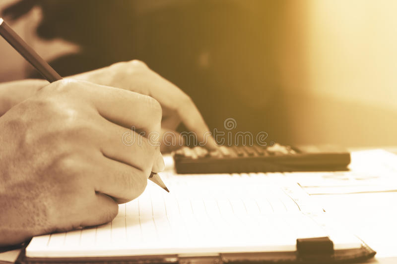 Close up young woman with calculator counting making notes at ho royalty free stock photos
