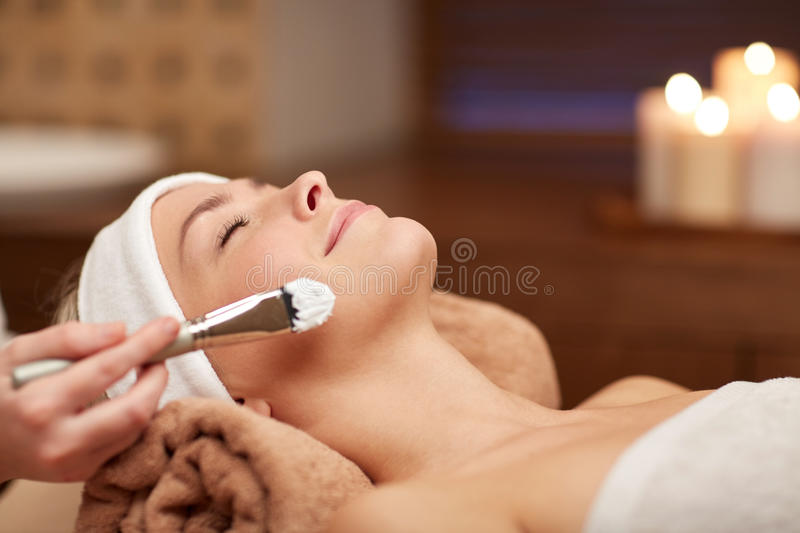 Close up of young woman and cosmetologist in spa royalty free stock photos