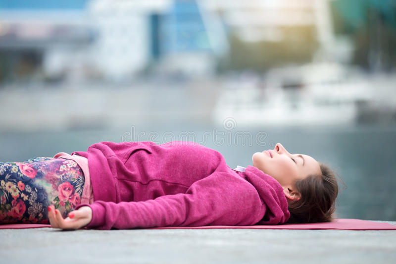 Close up of a young woman in Dead Body pose royalty free stock photo
