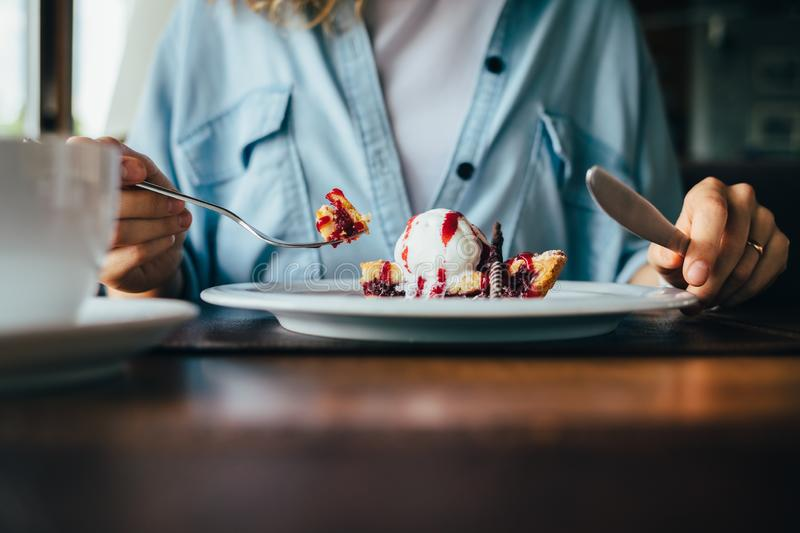 Close-up of young woman eating dessert royalty free stock photography