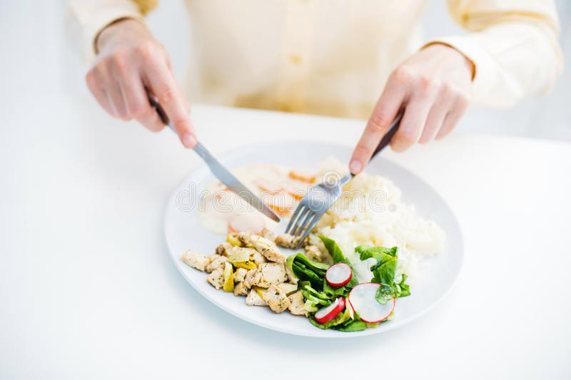 Close up Young woman eating healthy food having lunch meal royalty free stock images