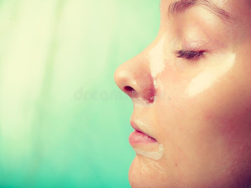 Close up woman in facial peel off mask. Close up young woman in facial peel off mask. Peeling. Beauty and skin care. e view stock images