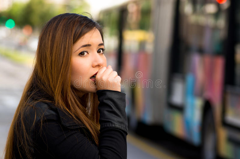 Close up of a young woman with protective mask coughing on the street in the city with air pollution, blurred public. Transport background stock images