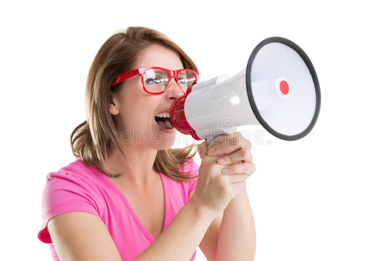 Close up of young woman shouting into bullhorn. Over white background royalty free stock images