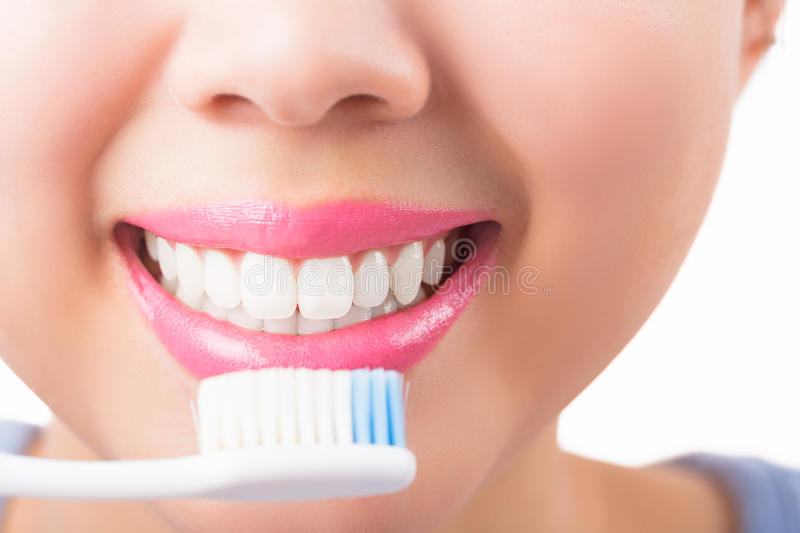 Close up young woman smiling white glamour teeth. stock photos