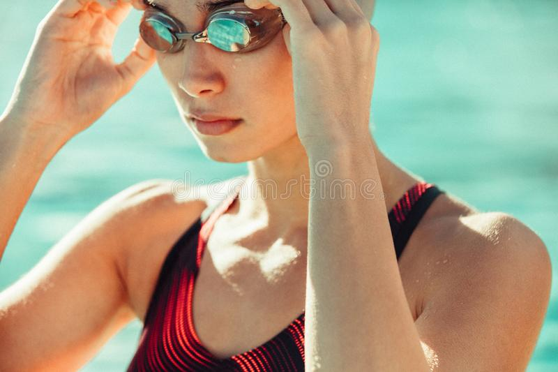 Female swimmer ready to swim royalty free stock photo