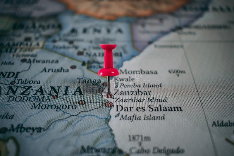 Close up of Zanzibar pin pointed on the world map with a pink pushpin stock image