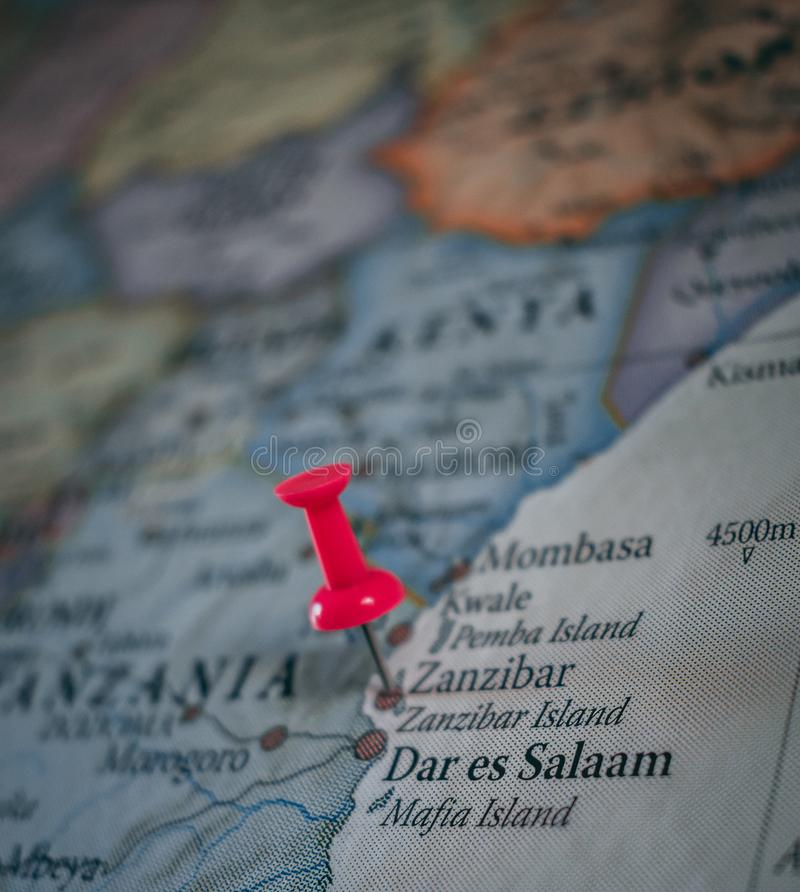 Close up of Zanzibar pin pointed on the world map with a pink pushpin stock photos