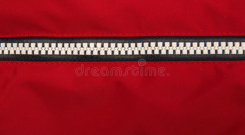 Close up zipper. On a red background royalty free stock photo