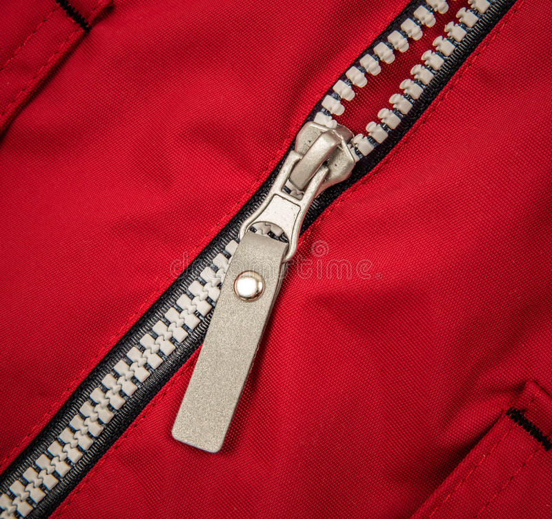 Close up zipper. On a red background royalty free stock image