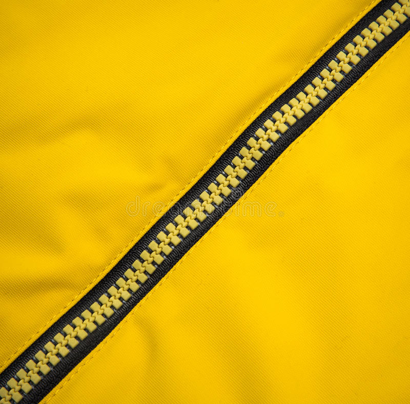 Close up zipper. On a yellow background stock photography
