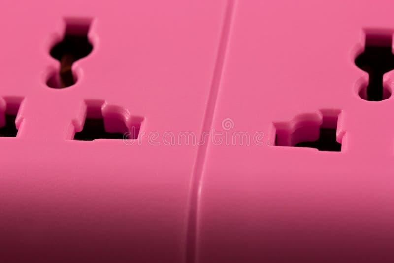 Close-upbeeld van een roze afzet op zwarte. stock foto