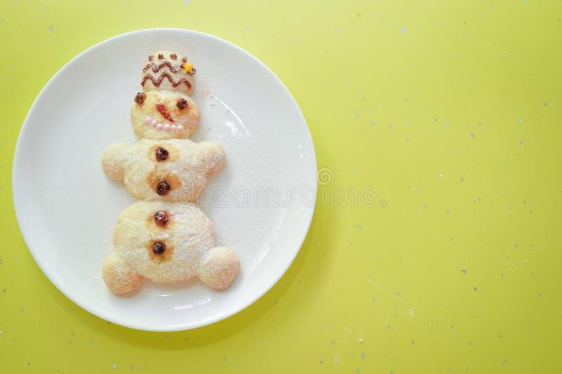 Close-upbeeld van Kerstmissneeuwmannen op wit royalty-vrije stock foto's