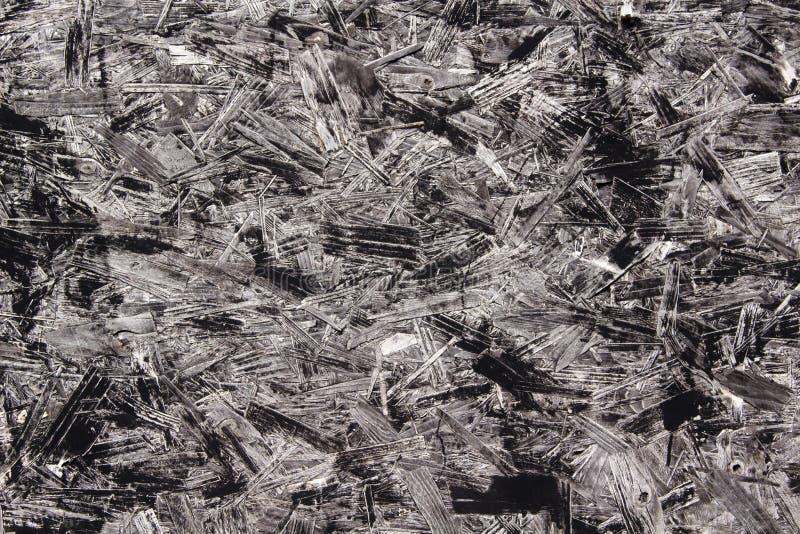 Close-upbeeld van zwarte spaanplaat stock afbeelding