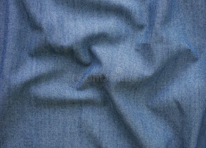 Close-updetail van de blauwe achtergrond van de de stoffentextuur van Jean royalty-vrije stock fotografie