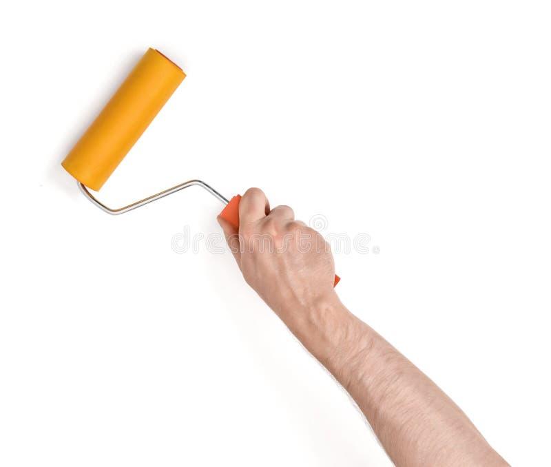 Close-upmening van man hand met verfrol, op witte achtergrond wordt geïsoleerd die stock afbeelding