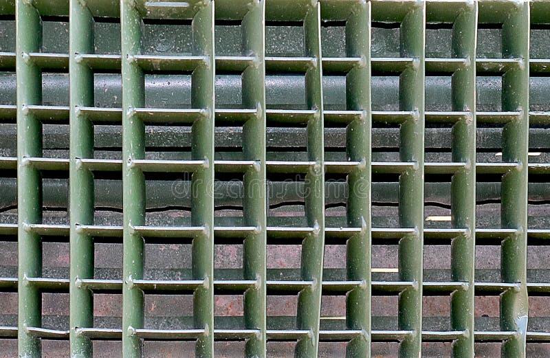 Close-upmening van militaire van de autoradiator textuur als achtergrond stock foto's