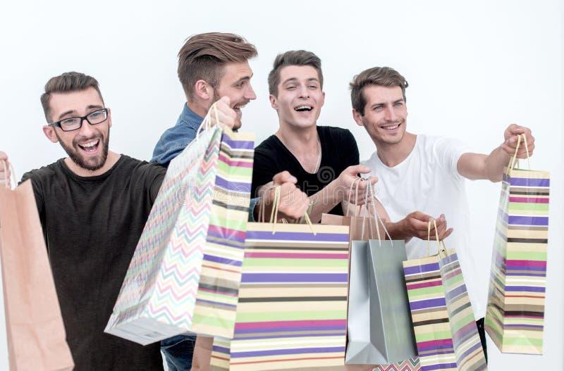 close upp en grupp av vänner med shoppingpåsar som pekar på dig fotografering för bildbyråer