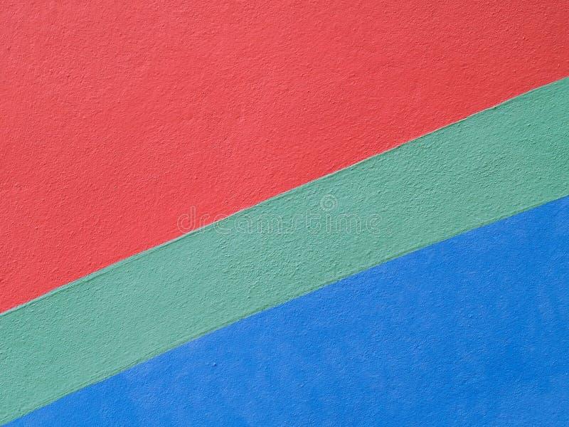 Close-uppatroon van kleurrijke geschilderde rode groenachtig blauw op concrete muur of sportenbenedenverdieping stock afbeelding