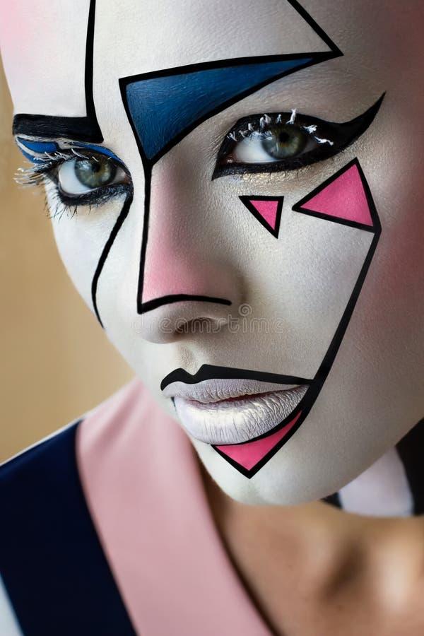 Close-upportret, mooi meisjesmodel met creatief grafisch gezichtsart. stock fotografie