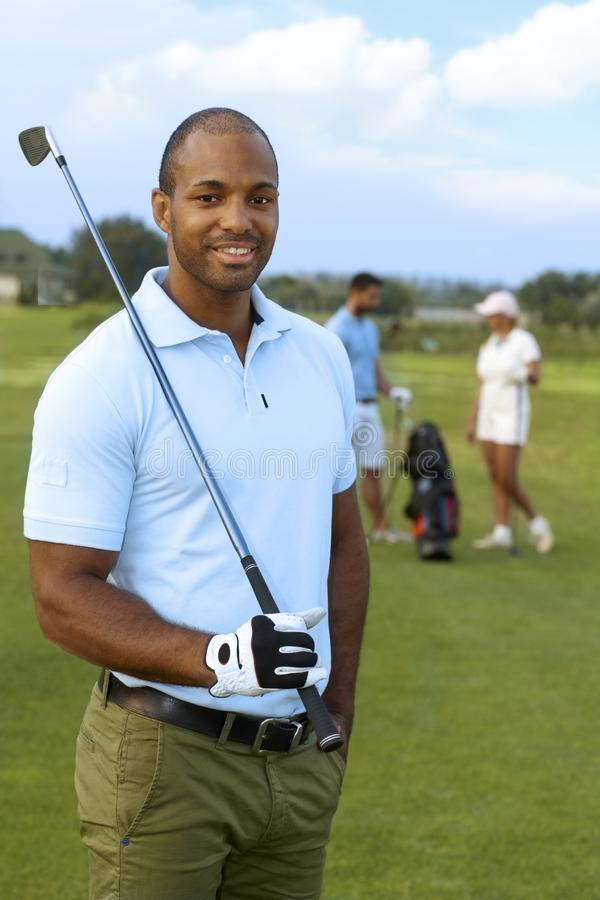 Close-upportret van atletische mannelijke golfspeler royalty-vrije stock afbeeldingen