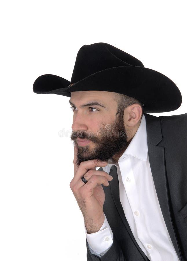 Close-upportret van de mens in een kostuum en cowboyhoed royalty-vrije stock afbeeldingen