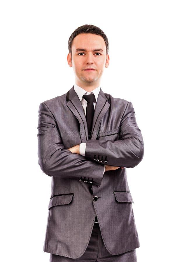 Close-upportret van een jonge zakenman met gevouwen wapens royalty-vrije stock afbeeldingen