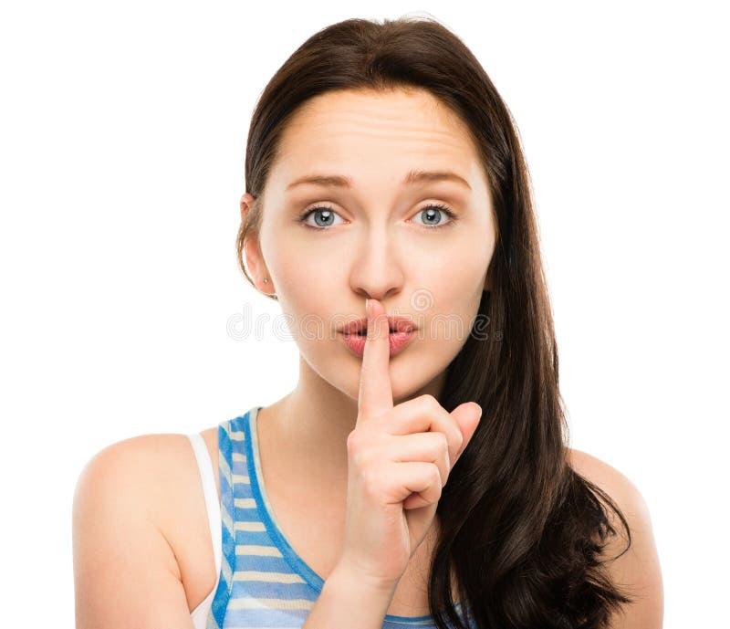 Close-upportret van vrij geïsoleerde vrouw met vinger op lippen royalty-vrije stock afbeeldingen