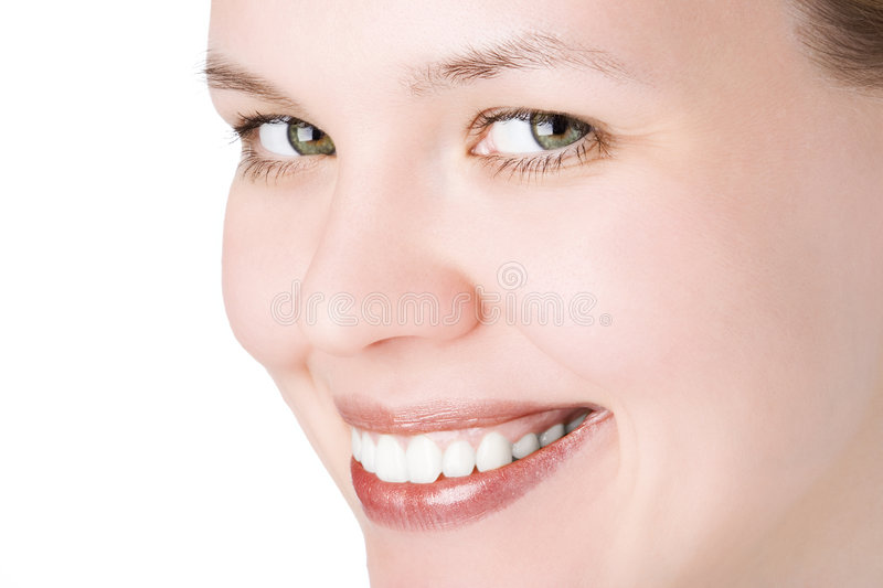 Close-ups face. Close-ups joyful face girl looks in staff and wide smile white teeth over white background stock photo